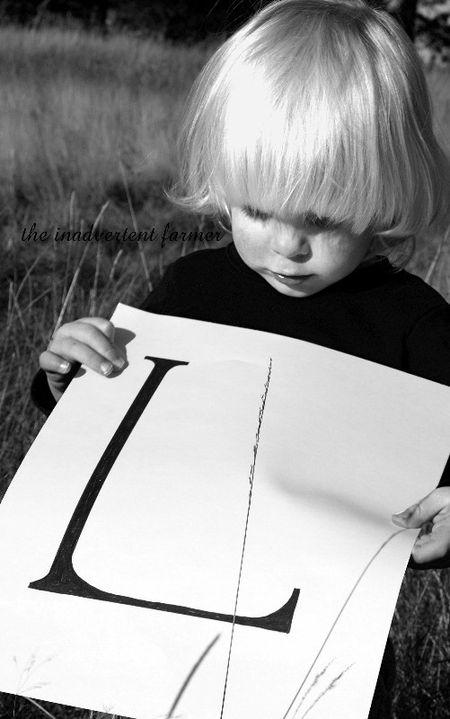 L blond boy black white field