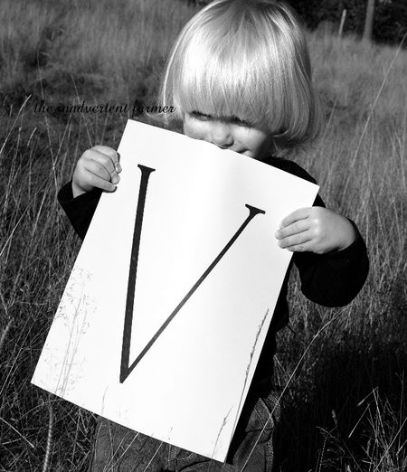 V black white toddler blond boy