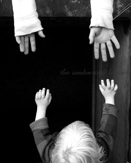 Brothers hands reach toddler blond boy Standard e-mail view