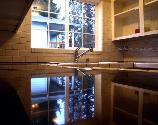 Black granite counter kitchen white cabinets remodel