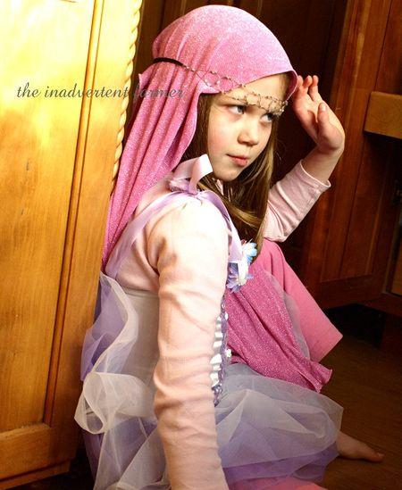 Indignent ballerina princess pink head scarf tutu sad