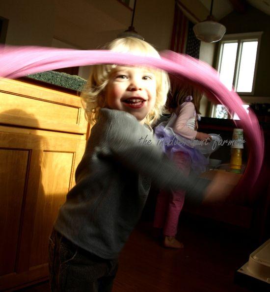 Little boy pink scarf twirl