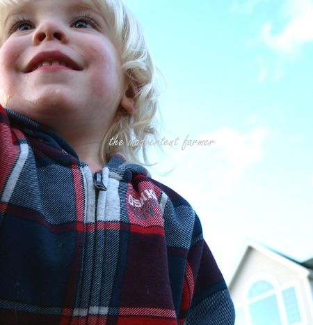 Little blond boy sky blue