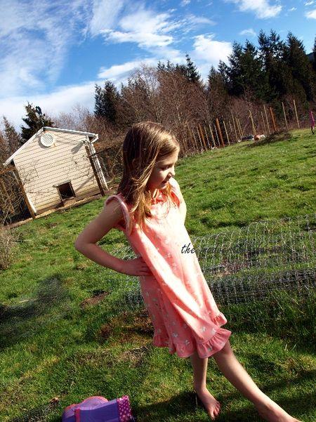 Little girl in garden bare feet winter