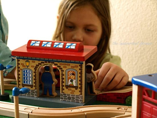 Train set wooden station girl play