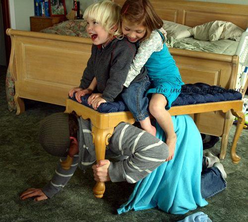 Kids ride big brother bench
