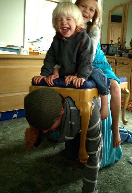 Kids laugh ride big brother bench