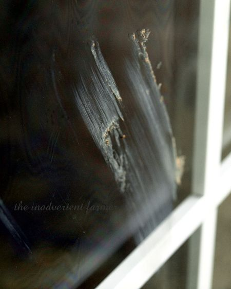Muddy handprint glass door
