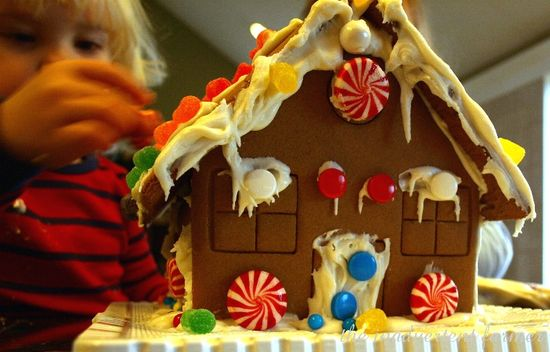 Gingerbread house boy decorate candy