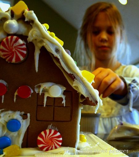 Gingerbread house girl decorate candy