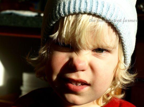 Little boy blue hat green eyes blond frown curls