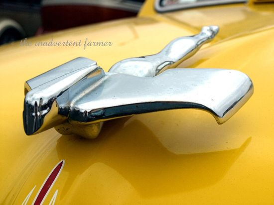 Chrome angel old car hotrod yellow