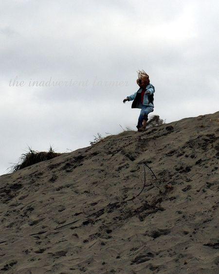 Jump beach sand oregon coast girl