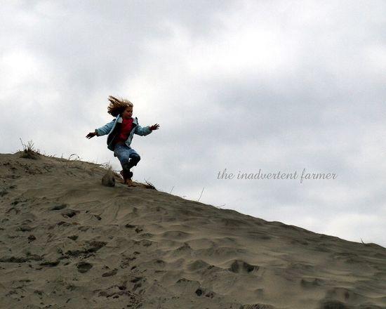 Girl run sand dune bare foot oregon coast beach