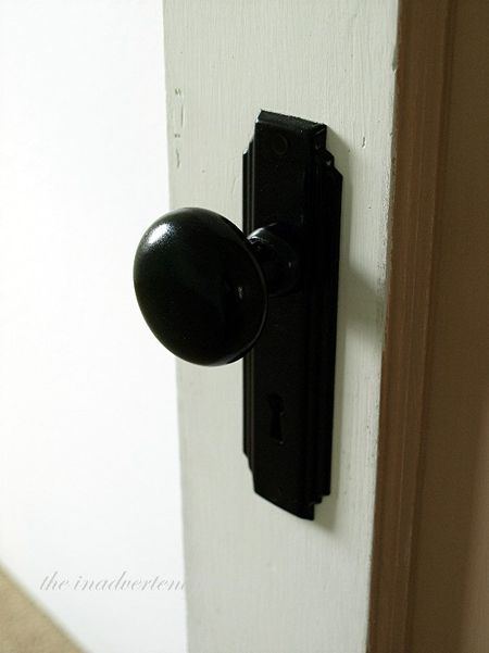 Old black door handle knob plate house