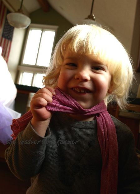 Little boy pink scarf grin play
