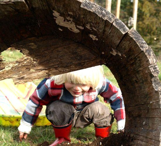 Little blond boy garden boots