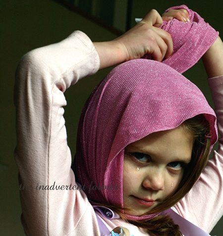Sad pink ballerina head scarf tears princess little girl