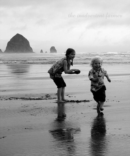 Little boy run beach oregon pacific ocean coast haystack rock