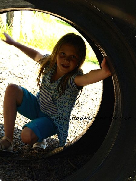 Upsidedown little girl kneel