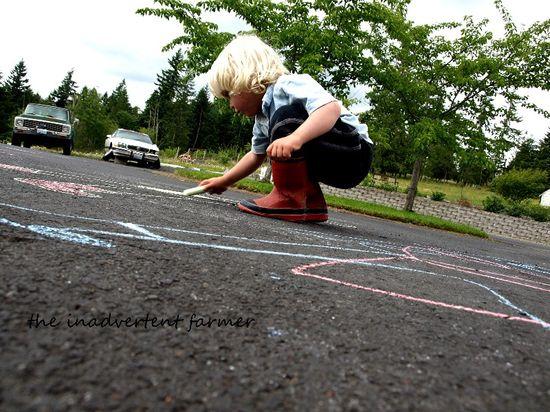 Sidewalk chalk drawing boy