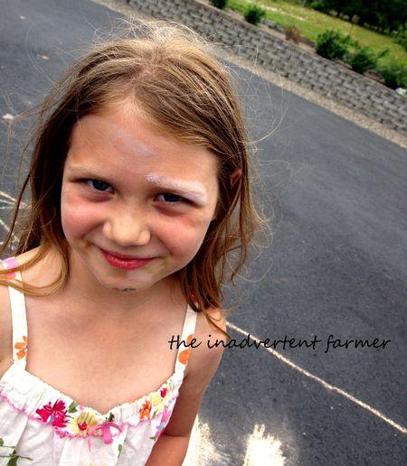 Sidewalk chalk girl face