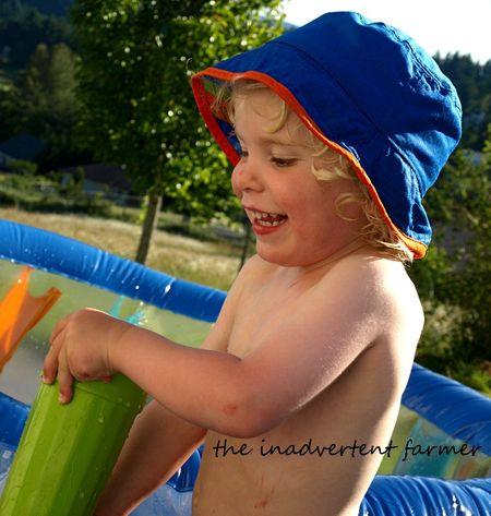 Boy pool smille blond hat summer