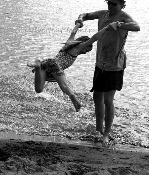 Beach girl swing with dad