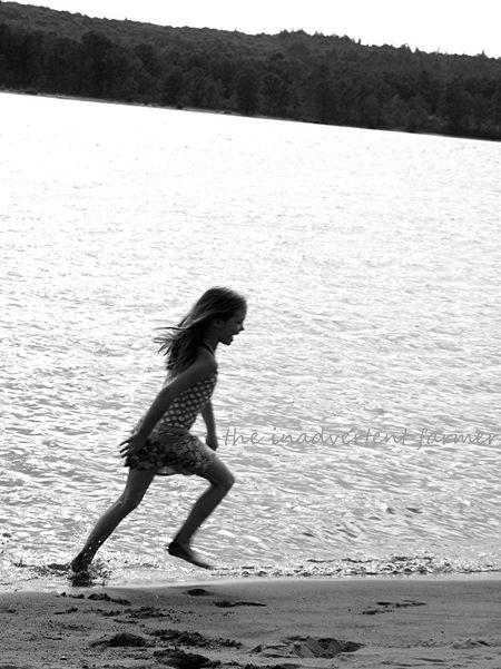 Beach girl laugh black white