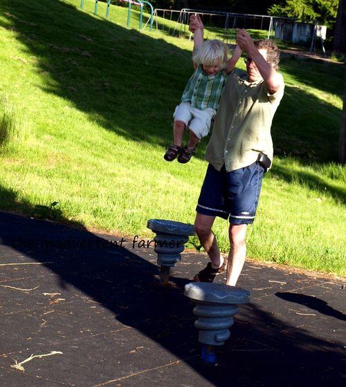 Playground jump little boy