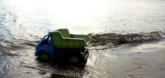 Dump truck in water beach