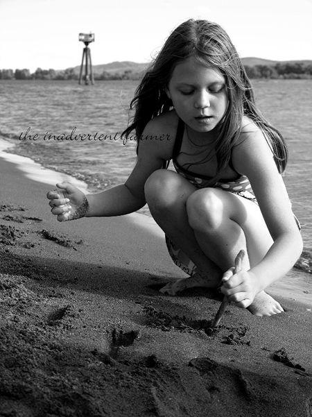Sand writing little girl black white
