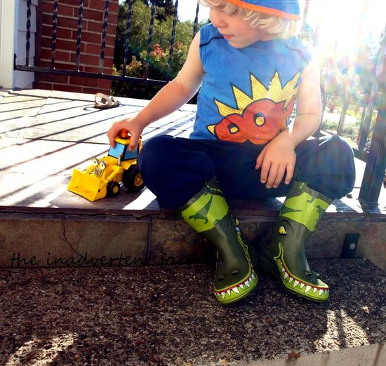 Boy dinosaur boots play