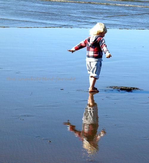 Beach reflection boy