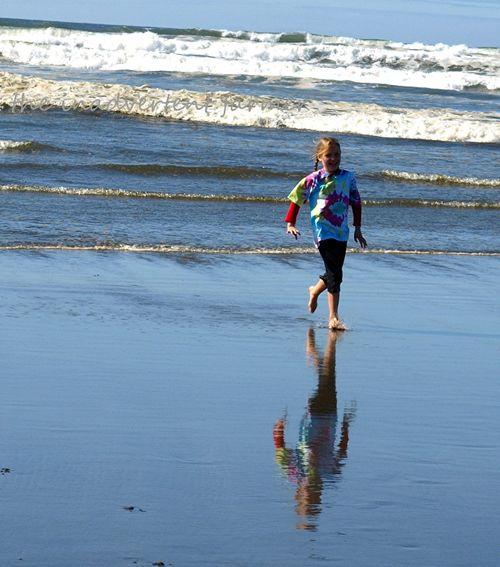 Beach reflection girl run