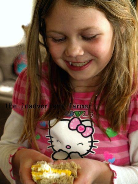 Big kids egg sandwhich grin girl