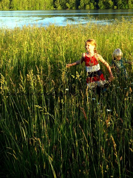 Grassy field kids run