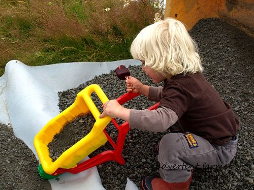 Hauling gravel boy wheelbarrow dump