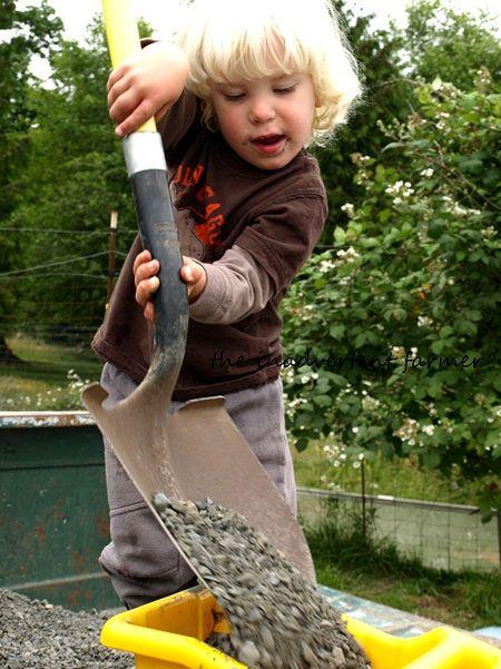Hauling gravel little boy big shovel