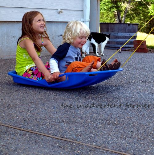 Grass sledding patio boy girl