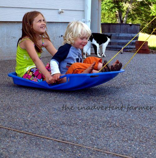 Grass sledding patio boy girl