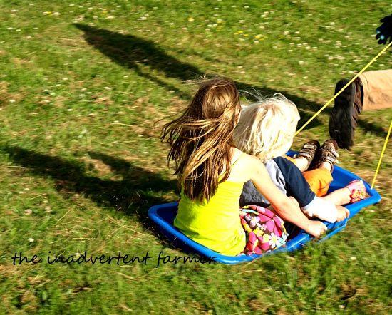 Grass sledding run girl boy
