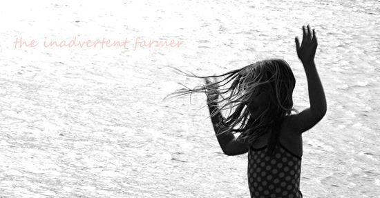 Beach girl hair blow black white