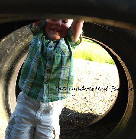 Upsidedown little blond boy stand