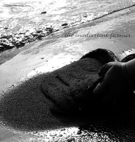 Black white sand hand baby