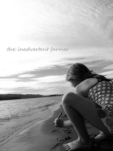 Beach girl write in sand black white