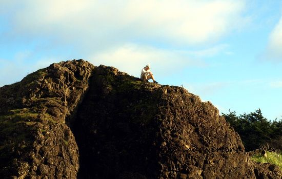 Man on rock beach
