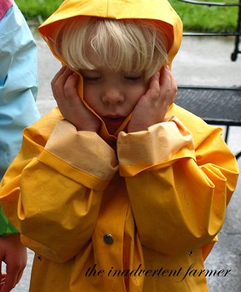 Boy sad yellow raingear