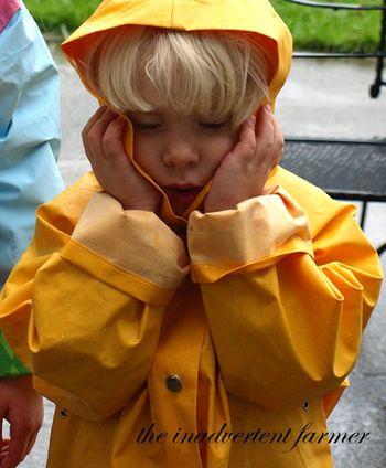 Boy sad yellow raingear