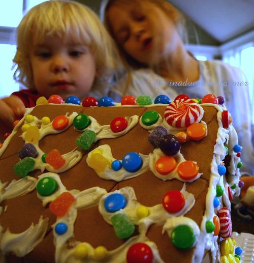 Kids decorate gingerbread house